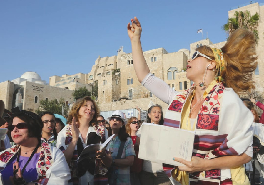 MEMBERS OF Women of the Wall pray at the Kotel.