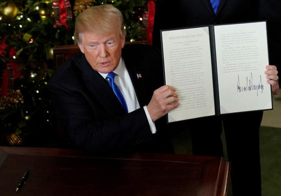 US President Donald Trump displays an executive order after he announced the US would recognize Je