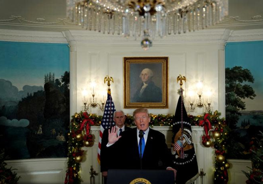 US President Donald Trump, flanked by Vice President Mike Pence, delivers remarks recognizing Jerusa