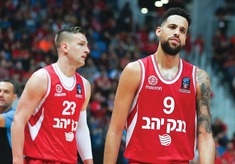 Hapoel Jerusalem forward Austin Daye (right) had every reason to look dejected last night after the