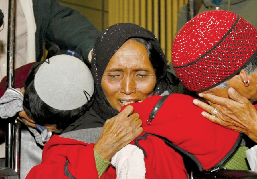 NEWLY ARRIVED Jewish immigrants from India cry upon arrival at Ben-Gurion Airport in 2006. The immig