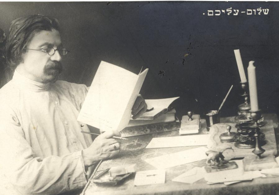 SHOLEM ALEICHEM at his desk in St. Petersburg in 1904
