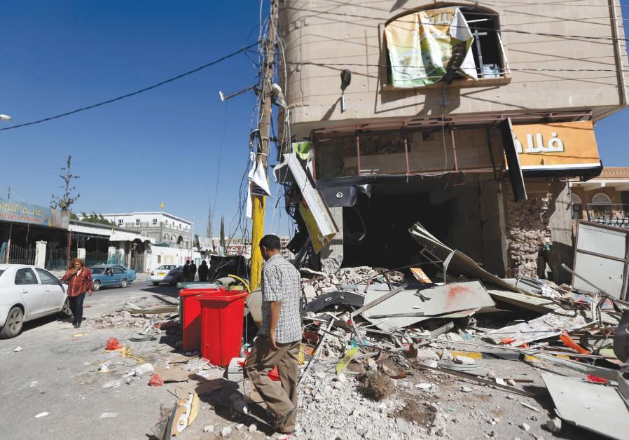 A MAN walks passed a destroyed building in Yemen's Sanaa.