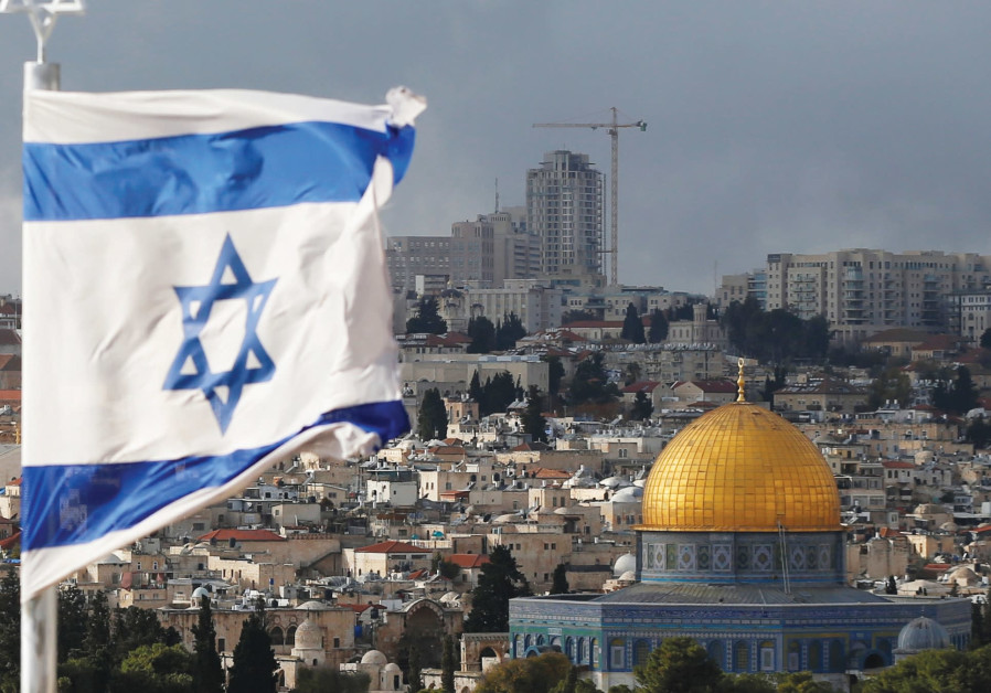 AN ISRAELI flag near the Dome of the Rock in Jerusalem's Old City.