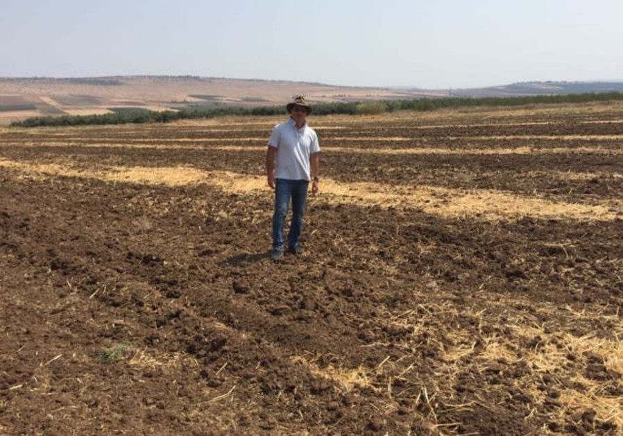David Tavdi walks on farmland in Israel