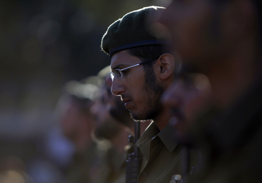 An Israeli soldier of the Ultra-Orthodox brigade takes part in a swearing-in ceremony in Jerusalem.