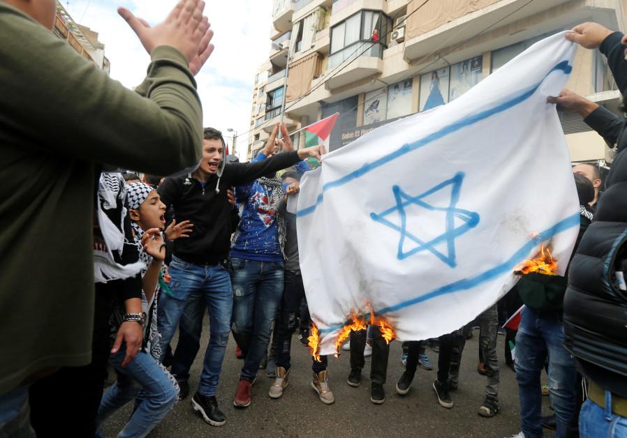 Protestors burn a makeshift Israeli flag in Beirut, Lebanon