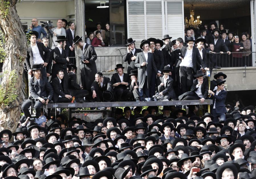 Ultra-Orthodox Jews attend the funeral of top spiritual authority Rabbi Aaron Yehuda Leib Shteinman in the central Israeli city of Bnei Brak on December 12, 2017  (Credit: Menahem Kahana / AFP)