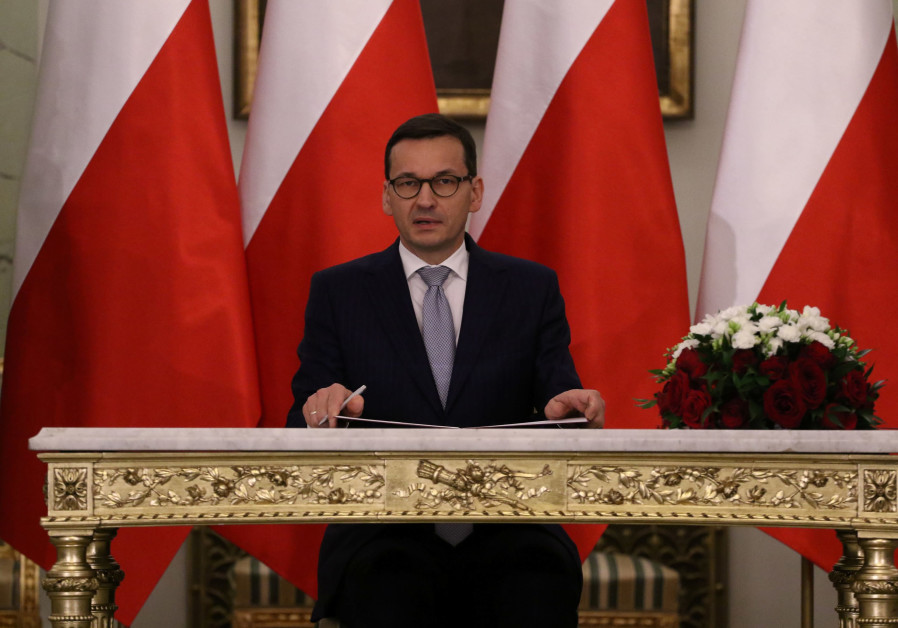 Polish Prime Minister Mateusz Morawiecki reacts after receiving his nomination during a government s