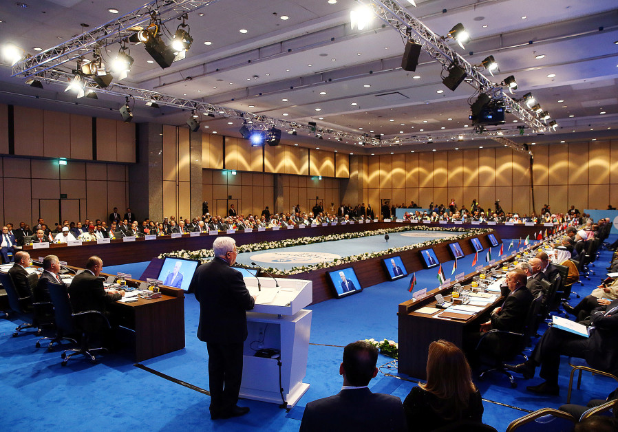 Palestinian President Mahmoud Abbas speaks during an extraordinary meeting of the OIC