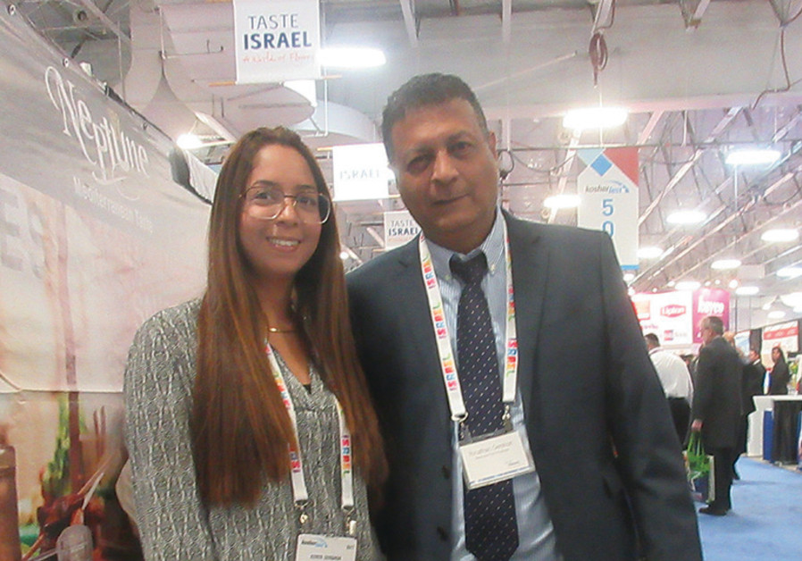 YONATAN GERSHON and daughter Keren are the owners of Neptune Foods of Beersheba. They displayed a wi