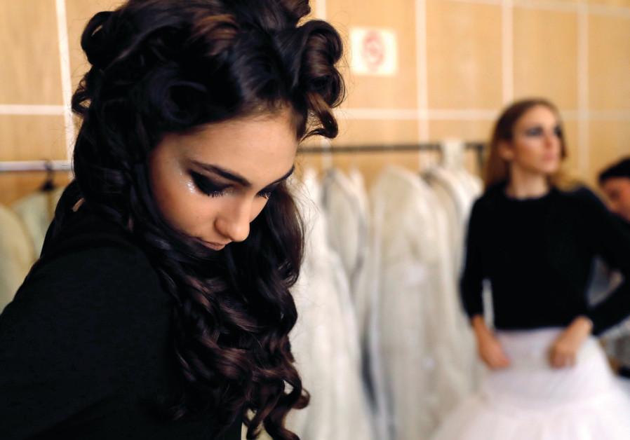 MODELS TRY on dresses during a fashion event aimed at Orthodox Jewish women early this year in Jerus