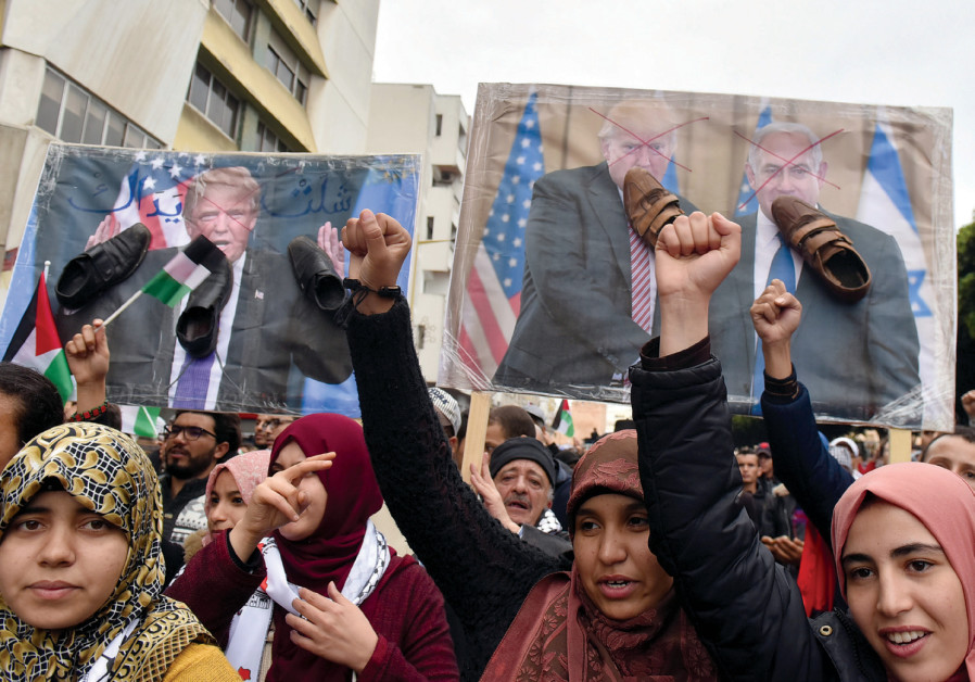 DEMONSTRATORS SHOUT slogans during a protest against the US intention to move its embassy to Jerusal