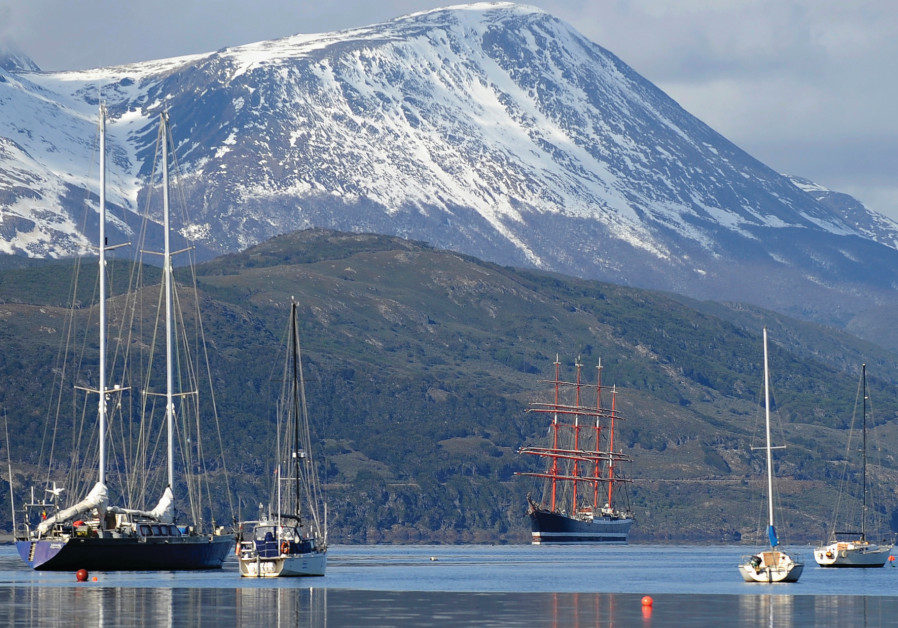 A FOUR-MASTED ship sails toward the port of the world's southernmost city of Ushuaia, at the very so