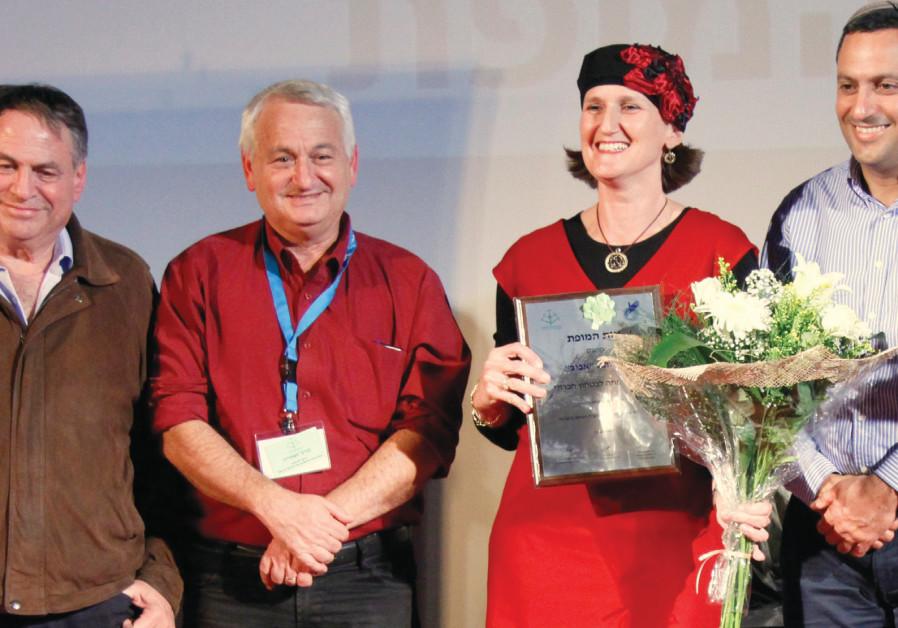 Aviv Le Nitzolei HaShoah receives a medal for social excellence. The NGO's CEO Aviva Silberman is pi