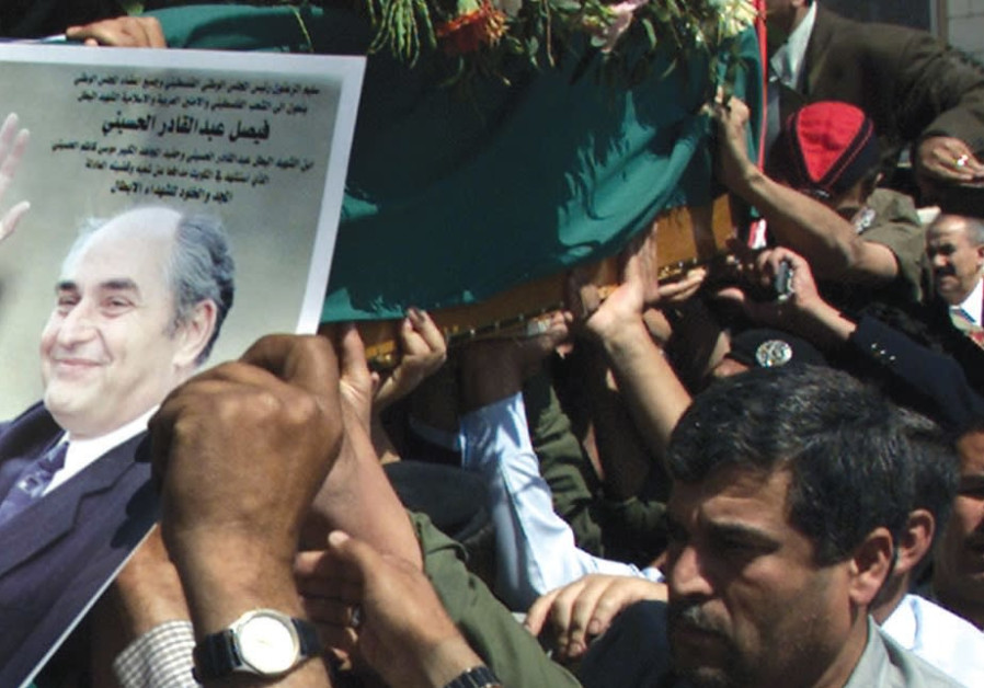 PLO OFFICIALS carry the coffin of Palestinian minister for Jerusalem, Faisel al-Husseini, in 2001 on