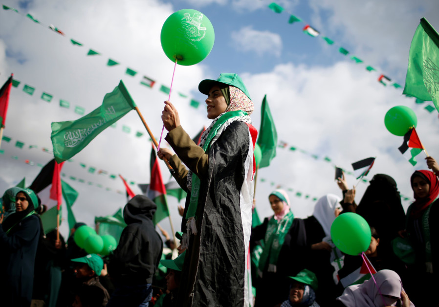 Palestinians supporting Hamas at a rally marking the 30th anniversary of Hamas' founding, in Gaza
