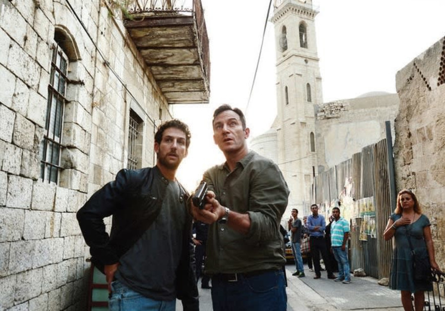 JASON ISAACS (right) and Ori Pfeffer on the set of the US TV show 'Dig.'  The show, produced by NBCU