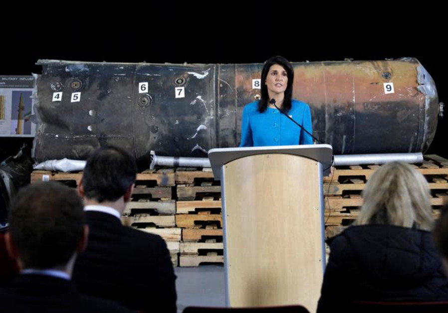 """US Ambassador to the United Nations Nikki Haley in front of remains of Iranian """"Qiam"""" missile."""