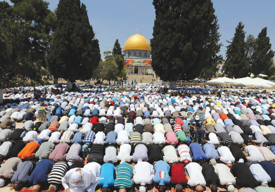 MUSLIMS PRAY next to Al-Aqsa Mosque in Jerusalem.