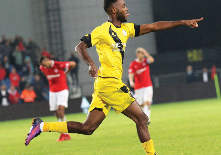 Maccabi Netanya forward Didier Kougbenya celebrates after scoring the winner in a 1-0 victory over H