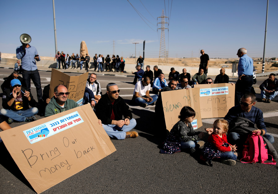 Teva Pharmaceutical Industries workers block a road during a demonstration near the facility