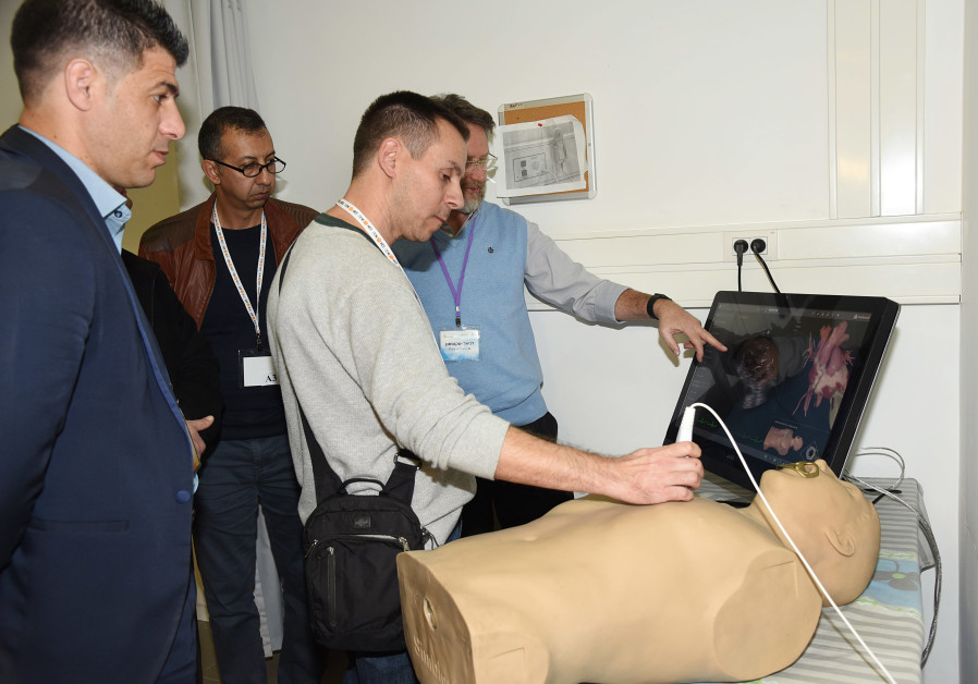 Physicians attend an ultrasound training at Soroka University Medical Center