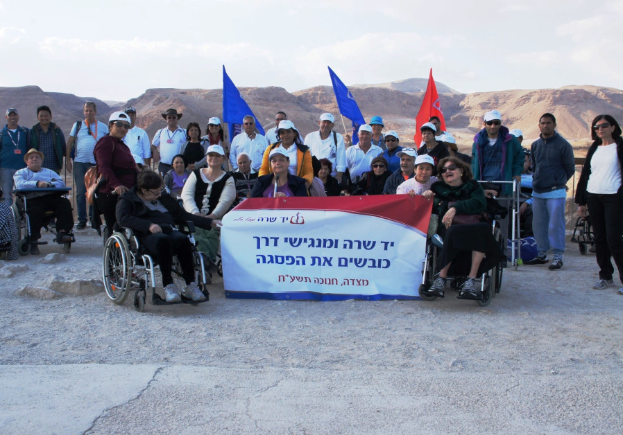 A group of wheelchair-bound Israelis visits Masada, December 2017