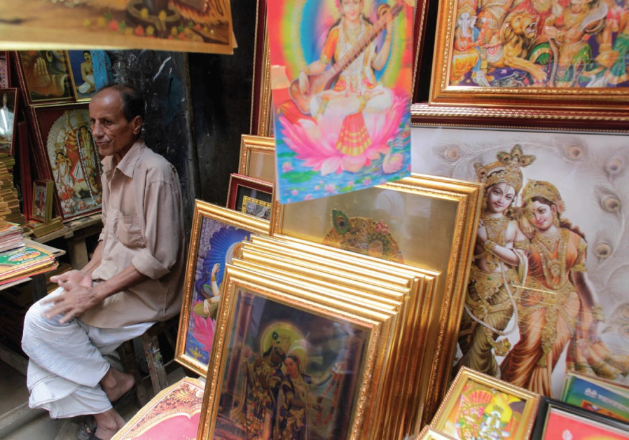 A VENDOR sells pictures of Hindu goddess during Durga Puja in old Dhaka.