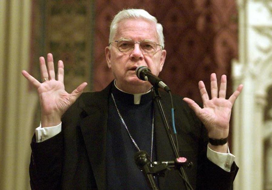 Boston's Roman Catholic Cardinal Bernard Law leads a prayer service for Boston area Catholic youth i