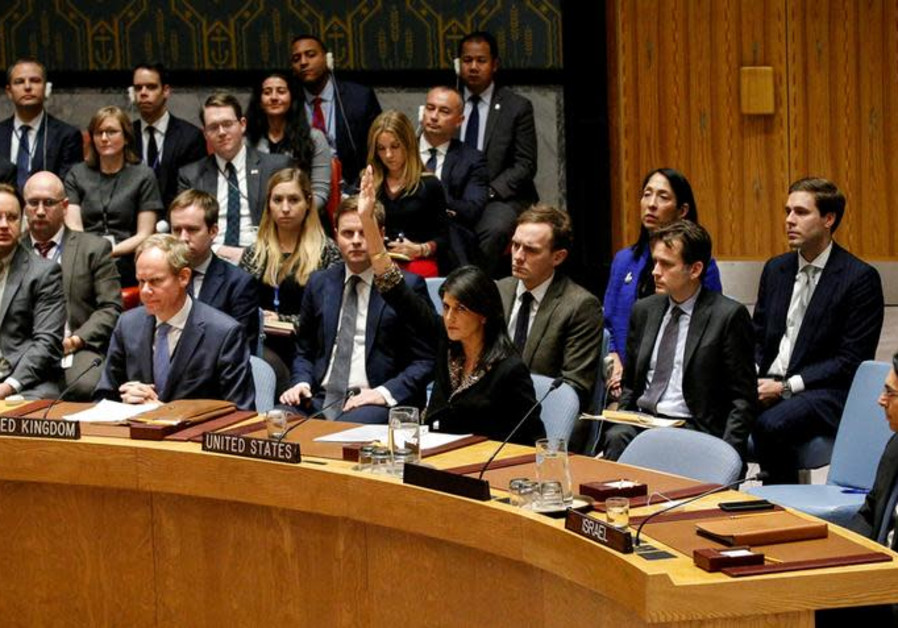 US Ambassador to the United Nations Nikki Haley vetos a resolution during the United Nations Securit