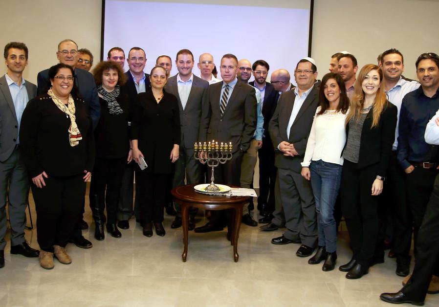 Strategic Affairs Minister Gilad Erdan lights candles with anti-BDS activists from Jewish organizati