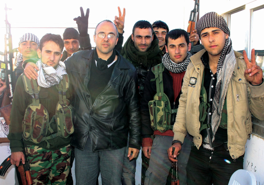 TERRANCE J. MINTNER (in the black leather jacket) with  ghters of the Kurdish YPG in Sereh Kaniyeh,