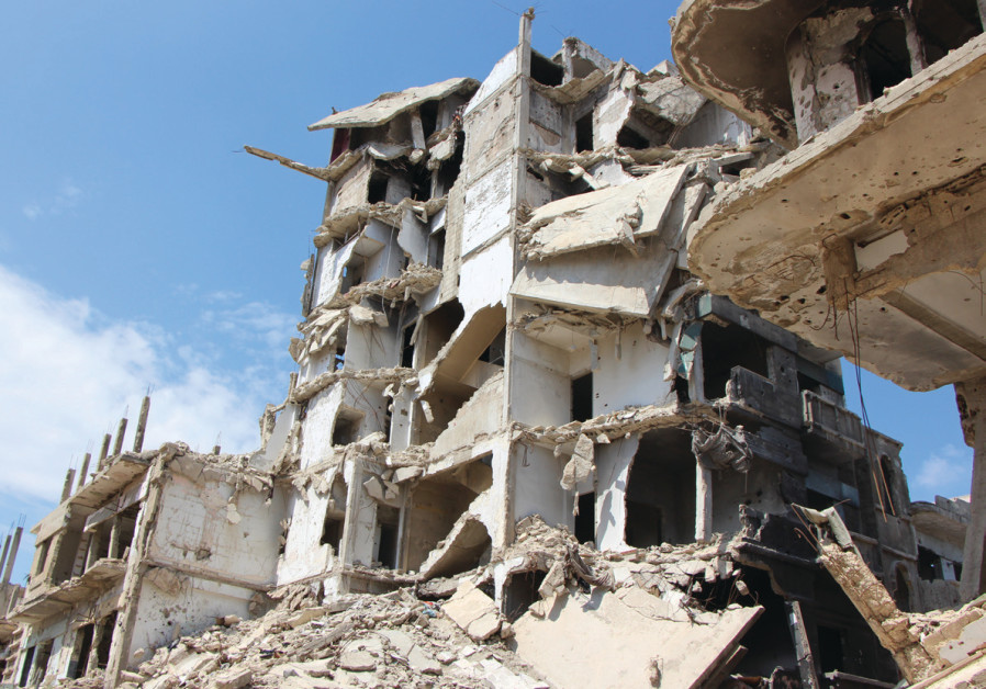 A BOMBED-OUT neighborhood of Homs, Syria, earlier this year