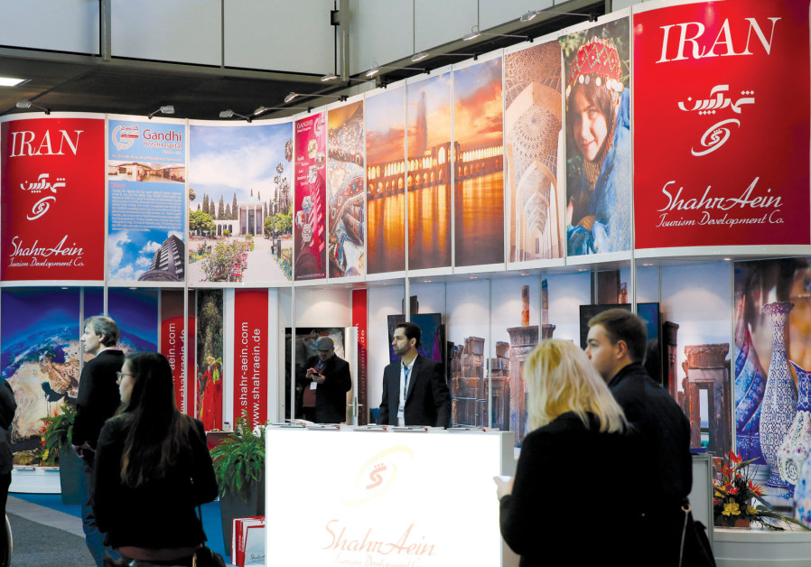 VISITORS BROWSE the exhibition stand of Iran at the International Tourism Trade Fair in Berlin last