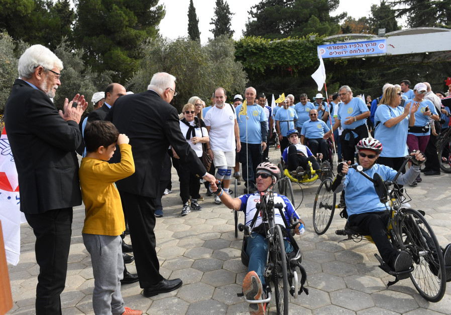 President Reuven Rivlin meets disabled veteran cyclists in Jerusalem