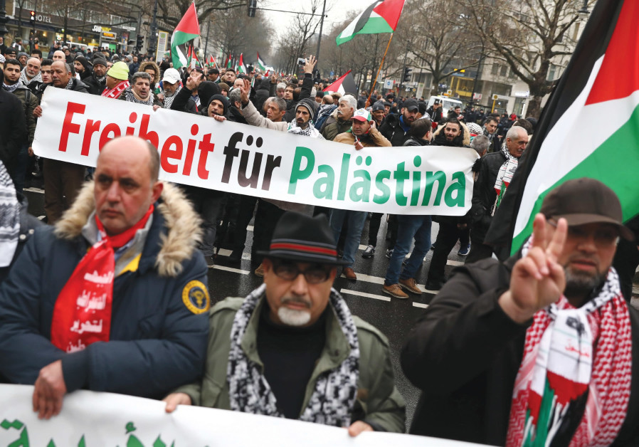 ANTI-ISRAEL PROTESTERS march during a demonstration in Berlin.