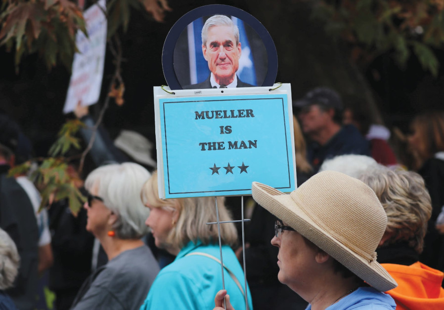 A DEMONSTRATOR holds a sign in support of special counsel Robert Mueller in Washington.