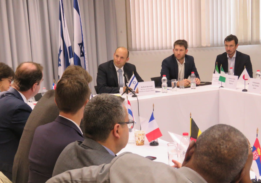 Education Minister Naftali Bennett briefs foreign diplomats ahead of the UNGA vote on Trump's Jerusa