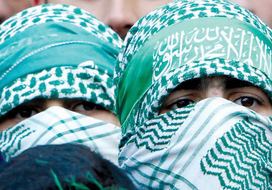 HAMAS SUPPORTERS take part in a rally in Nablus marking the 30th anniversary of the movement's found