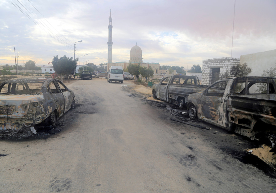 Damaged vehicles are seen after a bomb exploded at Al Rawdah mosque in Bir Al-Abed, Egypt November 2