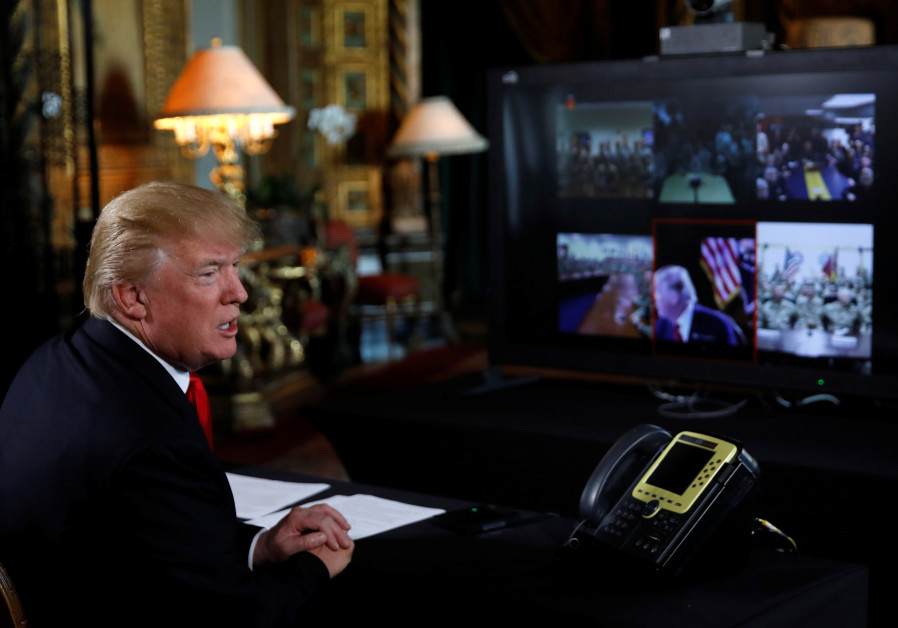 US President Donald Trump participates in a Christmas Eve video teleconference with members of the m