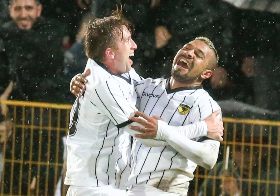 Beitar Jerusalem midfielder Claudemir (right) celebrating with Brazilian teammate Georginho.