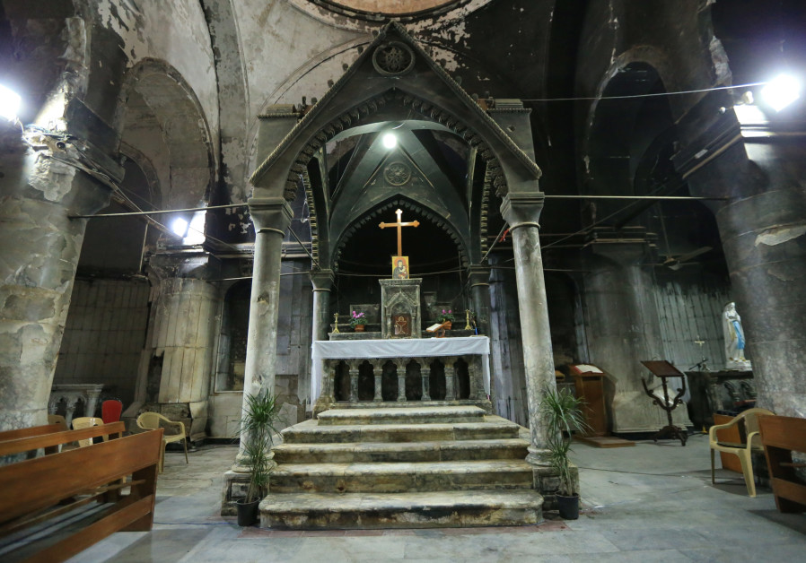 A burned church of the Immaculate Conception by Islamic State militants is seen in the town of Qaraq