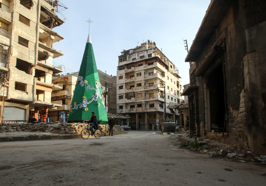 A Christmas tree is decorated in the Christian-majority neighbourhood of Hamidiyeh in Homs