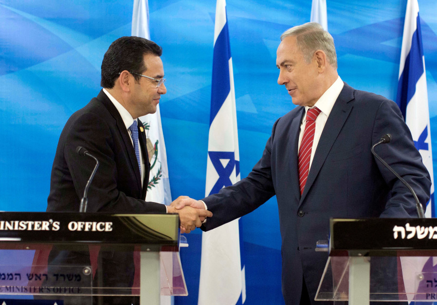 Guatemalan President Jimmy Morales and Israeli Prime Minister Benjamin Netanyahu shake hands as they