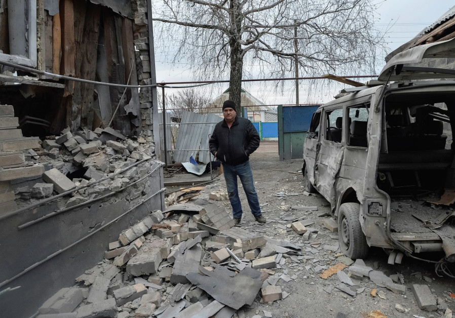 A MAN inspects his house, which was damaged by recent shelling, in the government-held village of No