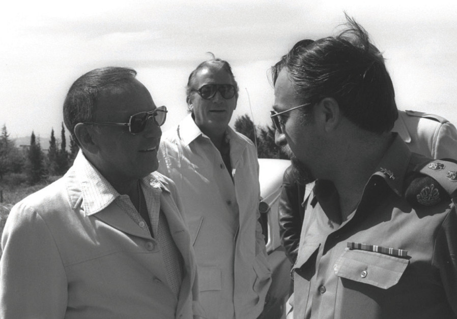 Frank Sinatra (left) and Gregory Peck talk to an IDF officer in Jerusalem in 1978, when he opened th