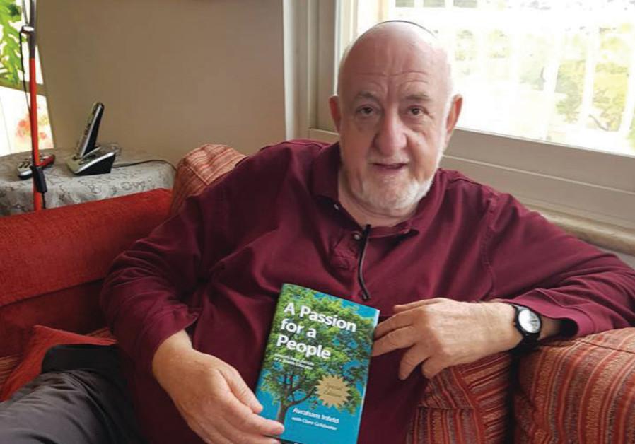 Israeli author Aharon AppelfeldAvraham Infeld holds his new book at his home in Jerusalem