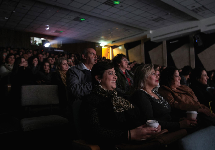 PEOPLE WATCH a screening of Arab Israeli film, 'In Between', at a cinema in Nazareth.